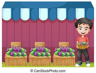 A boy selling grapes