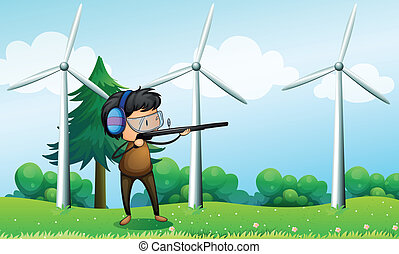 Illustration of a boy shooting in front of the windmills