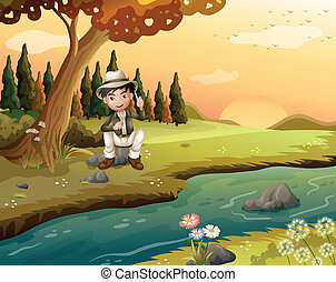 A boy sitting near the riverbank
