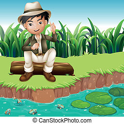 A boy sitting on a wood at the riverbank