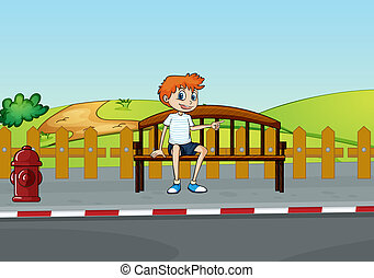 A boy sitting on the bench