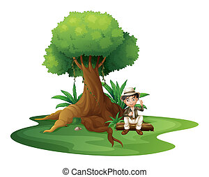 A boy sitting under the big tree