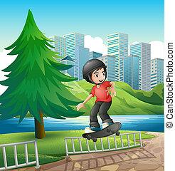 A boy skateboarding near the riverbank