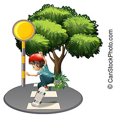 A boy skateboarding near the tree