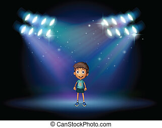 A boy smiling at the stage