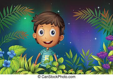 A boy smiling in the garden