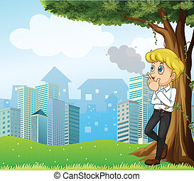 A boy smoking under the tree across the buildings