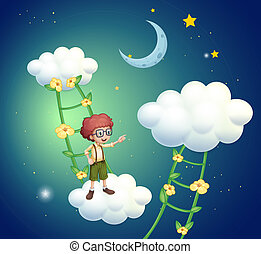 A boy standing above the clouds