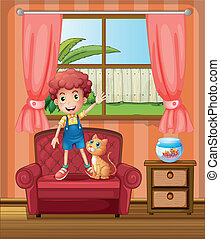 A boy standing at the sofa inside the house
