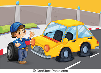 A boy standing in front of a car with a flat tire