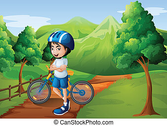 A boy standing in the middle of the pathway with his bike