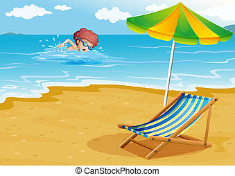 A boy swimming at the beach with a chair and an umbrella