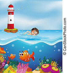 A boy swimming at the beach with a lighthouse