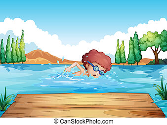 A boy swimming near the diving board