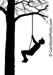 A boy swings on a tree