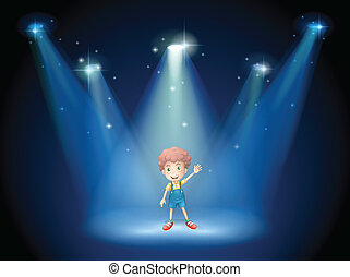 A boy waving his hand at the stage with spotlights
