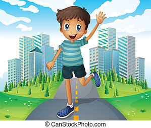 A boy waving while running in the middle of the road