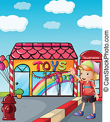 A boy wearing a hat waving outside the toy shop -...