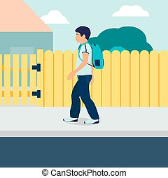 A boy with a backpack is walking along the street.