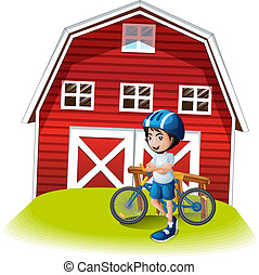 A boy with a bike standing in front of the farmhouse