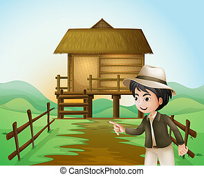 A boy with a hat standing near the nipa hut - Illustration...