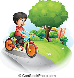 A boy with a red shirt biking