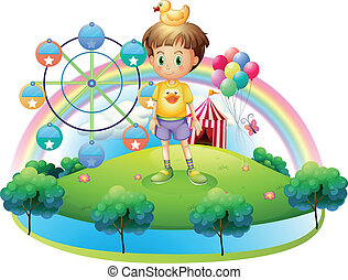 A boy with a rubber duck in an island with a carnival