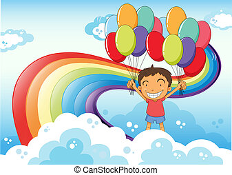 A boy with balloons standing near the rainbow