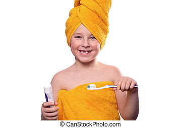 A boy without one tooth with a toothbrush isolated on a white background