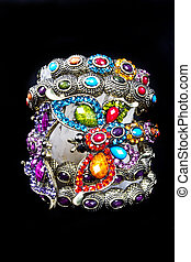 A bracelet is an article of jewelry that is worn around the...