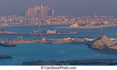 A breathtaking aerial view of the Palm Jumeirah during sunrise timelapse from a rooftop, Dubai, United Arab Emirates
