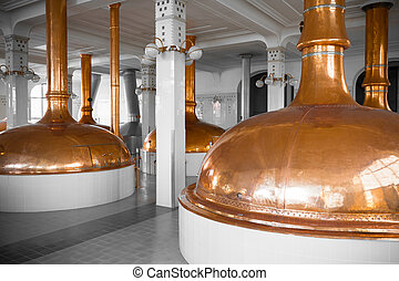 a brewery building interior, container cooking pots