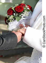 A bride and a groom with bouquet