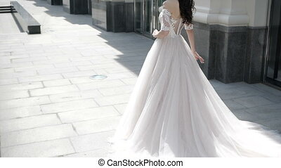 A bride is walking on the street