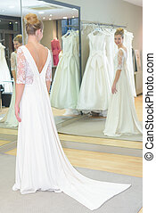 a bride-to-be trying on a wedding dress