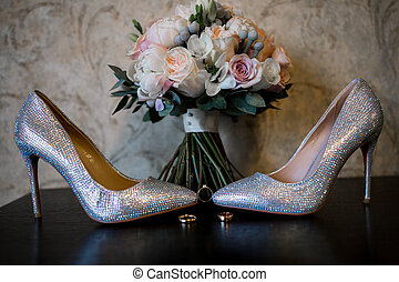 bride wedding shoes with gold rings