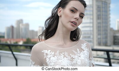 A bride with a brown hair close up. She is looking away