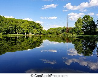 A bright beautiful day with reflection of clouds at Foley ...