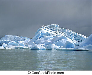 A bright iceberg with dark clouds