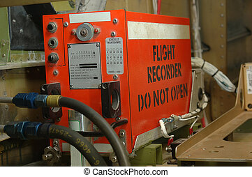 A bright orange flight recorder - the so-called black box - in a Dornier 228 commercial aircraft