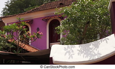 A brightly coloured building in rural India - A brightly...
