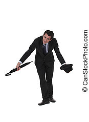 A British businessman bowing.