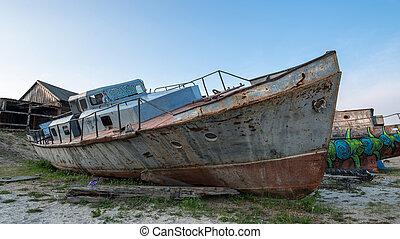 a broken iron boat
