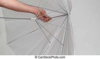 a broken umbrella for the photographer. ordering products via the Internet. defective photographic equipment.
