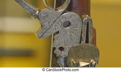 A brown and bronze shot gun inside the tower