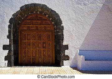 a brown closed wood  church door   spain canarias