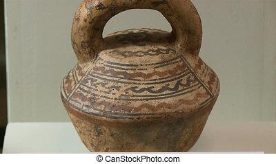 A brown vase in display