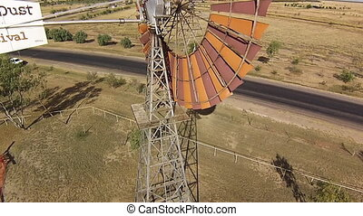 A brown windmill up close - An aerial drone shot of a brown...