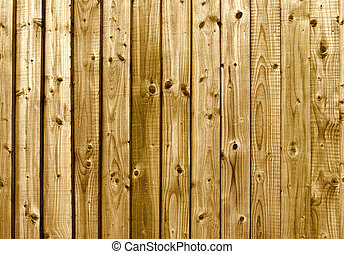 A brown wooden fence close up background.