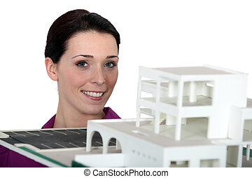 A brunette architect with a model.